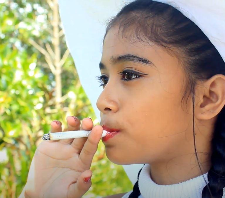A young girl smoking (educational video)